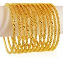 Click here to View - 22K Gold Bangle Set (12Pcs)